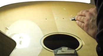 Scrape Acoustic Finish to Glue Bridge